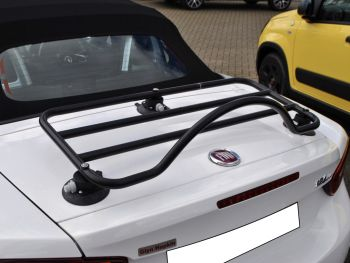 white fiat 124 spider with a revo-rack black luggage rack fitted