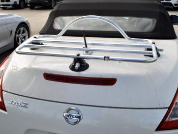 white nissan 370z convertible with a stainless steel luggage rack fitted