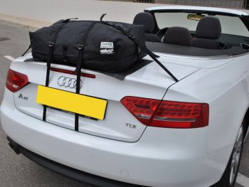 White Audi A5 Cabriolet with the hood down and a boot-bag original waterproof luggage bag attached