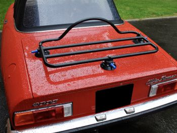 alfa romeo spider with a black boot rack fitted
