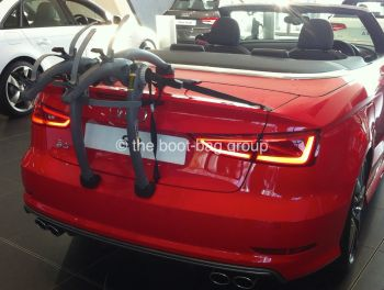 audi cabriolet in red hood down with a bike rack fitted