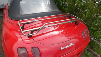 red fiat barchetta with a stainless steel luggage rack fitted