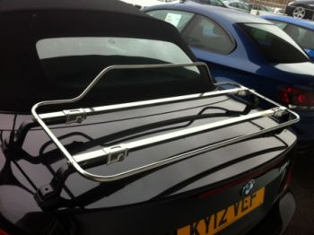 black bmw 1 series convertible with a stainless steel luggage rack fitted
