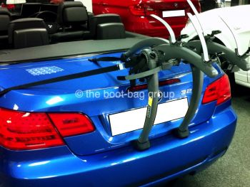 blue bmw 3 series e93 convertible with a bike rack fitted