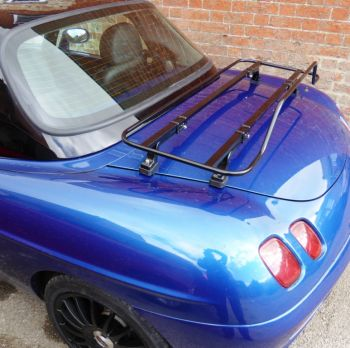 Blue Fiat barchetta with a black boot rack fitted