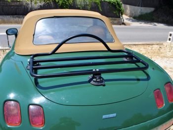 Green fiat barchetta with a cream roof with a revo-rack luggage rack fitted to the boot on a sunny day