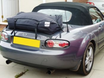 mazda mx5 mk3 luggage rack fitted to a dark silver nc mx5