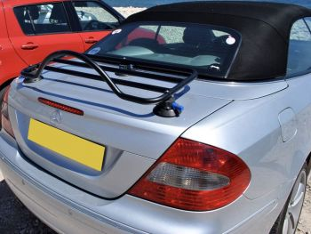 mercedes benz convertible clk in silver with a revo-rack black luggage rack fitted near the coast on a sunny day