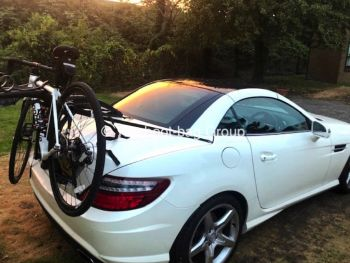 white mercedes slk r172 with a bike rack fitted carrying a mountain bike