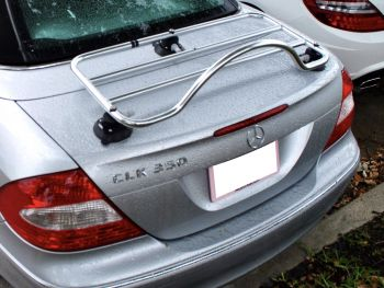silver mercedes clk convertible with a stainless steel luggage rack fitted photographed from above