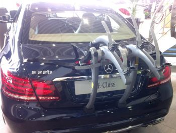 Black mercedes benz e class with a bike rack fitted