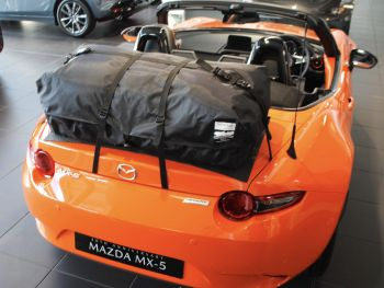 30th anniversary orange mazda mx5 with a boot-bag original boot rack fitted