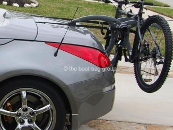 grey nissan 350z roadster with a bike rack fitted