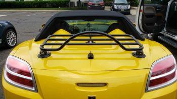 yellow opel gt cabriolet with a revo-rack luggage rack fitted