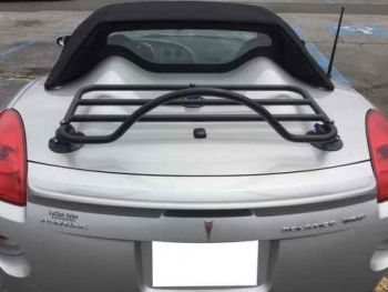 Silver Pontiac solstice with a black revo-rack luggage rack fitted