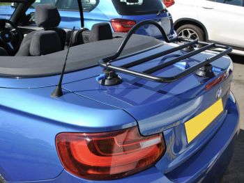 side view of a bmw 2 series convertible with a boot rack fitted hood down on a sunny day