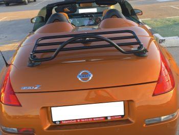 Copper Nissan 350z roadster with the hood down and a revo-rack black luggage rack fitted