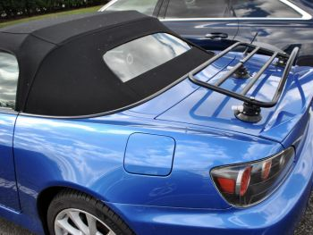 blue honda s2000 with a spoiler and a luggage rack fitted