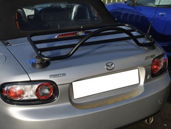 silver mazda mx5 miata nc mk3 with a revo-rack black luggage rack attached to the trunk/boot
