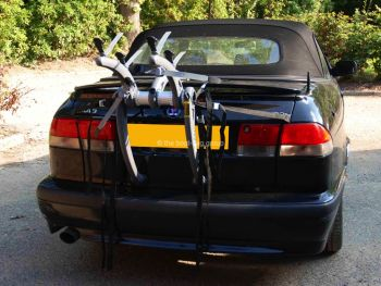 black saab 93 convertible with a bike rack fitted