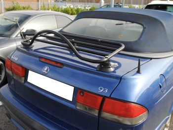 blue saab 93 convertible in car park with a black revo-rack luggage rack fitted