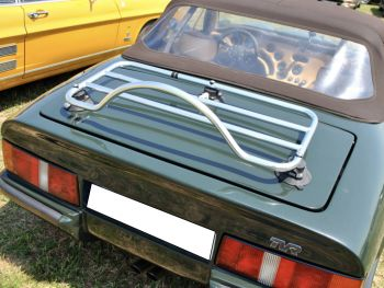green tvr s with a brown roof and a luggage rack fitted